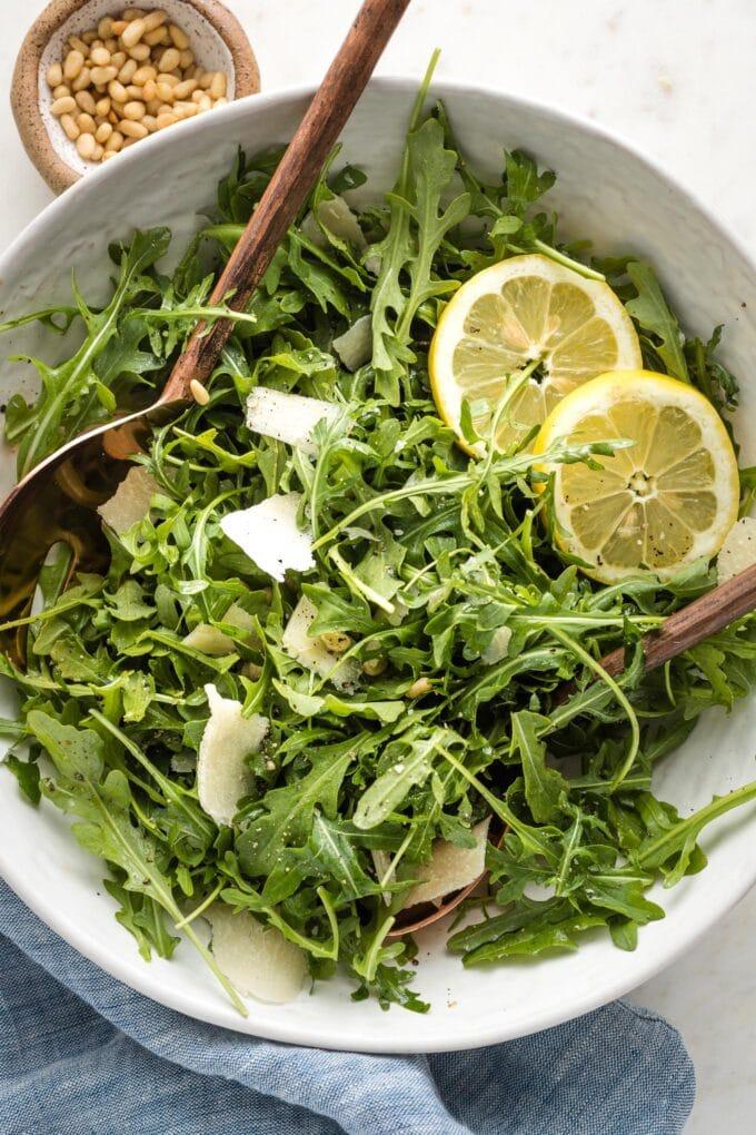 Salad tossed together in bowl.