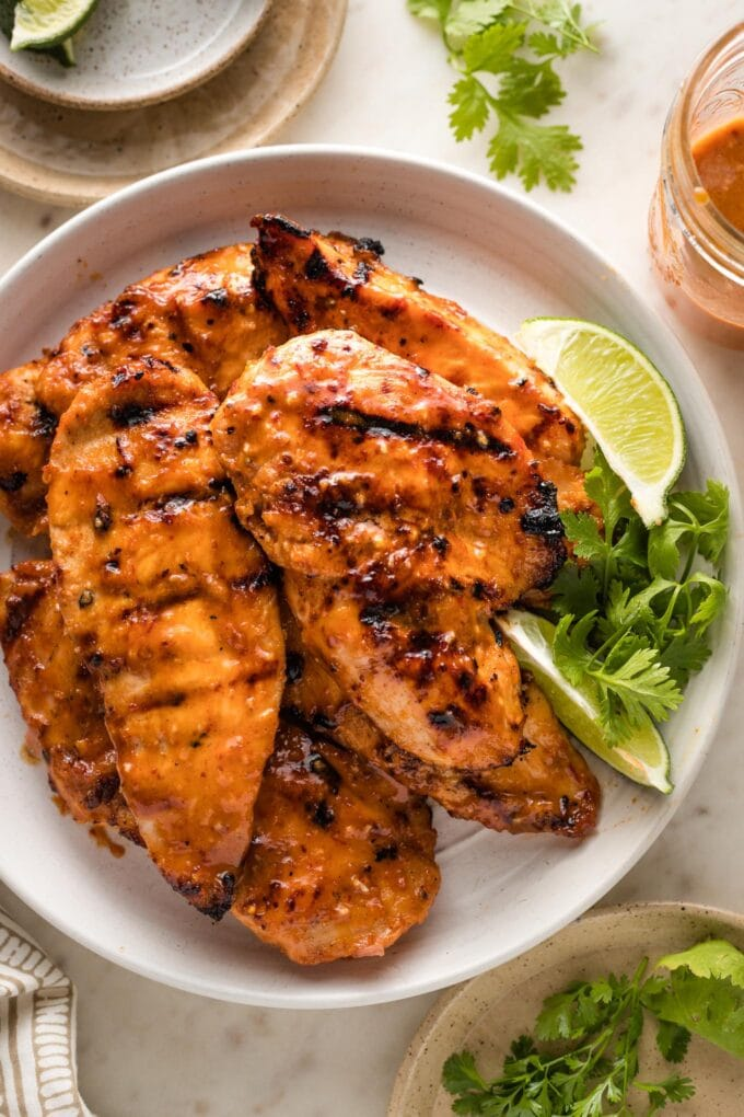 Small plate filled with grilled honey chipotle chicken breasts.