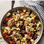 Enjoy Mediterranean cooking any weeknight with this easy 30-minute recipe for Greek chicken thighs with olives, tomatoes, and artichokes. This packs a ton of flavor into just one skillet, so cooking and clean-up are both a breeze. And with a few simple tricks, you'll learn how to deliver perfectly tender chicken each and every time. #greekchicken #easychickenrecipes #mediterraneanrecipes