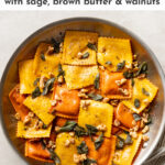 This easy recipe elevates store-bought pumpkin ravioli with sage brown butter sauce, toasted walnuts, and a surprise finishing touch. Seriously the best way to use Trader Joe's pumpkin ravioli! This is a dreamy fall dinner, and best of all it takes just 25 minutes! #pumpkinravioli #traderjoes #falldinnerrecipes