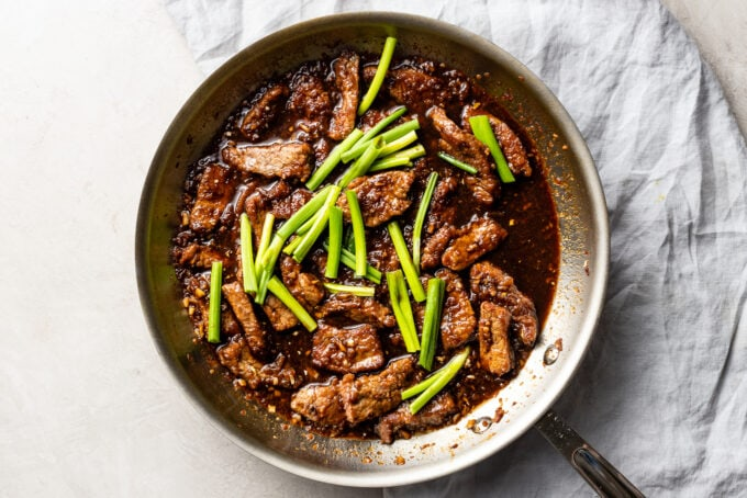A skillet full of finished Mongolian beef.