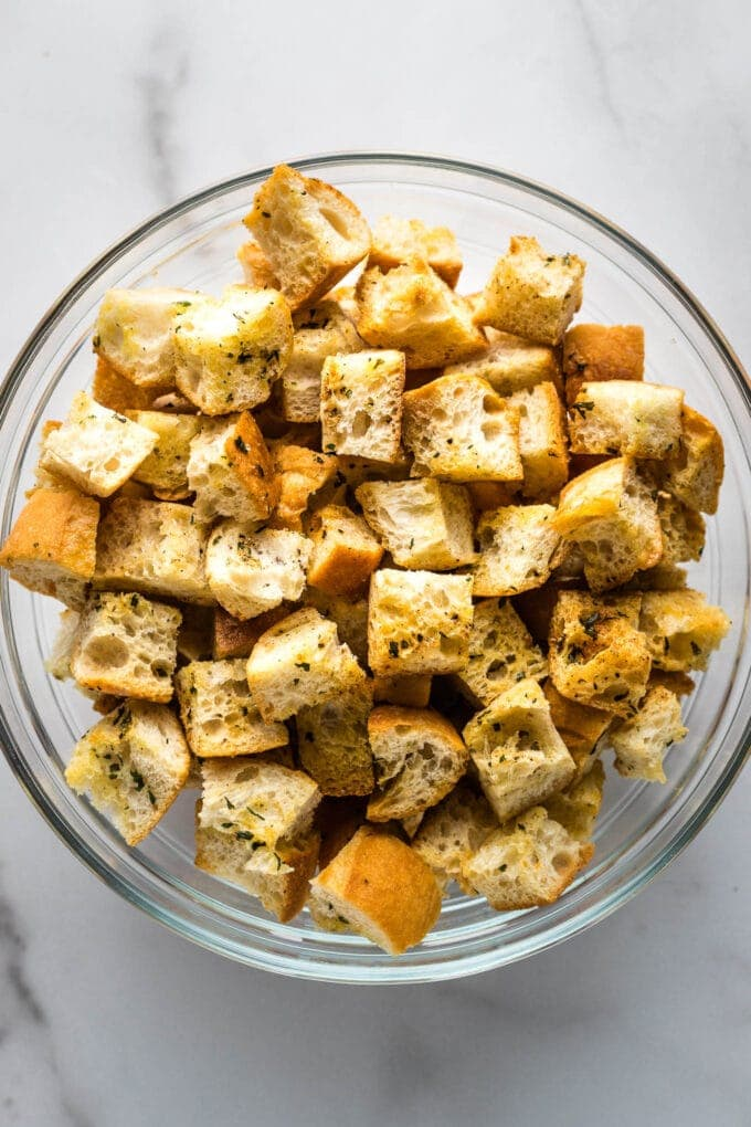 Close-up of crunchy croutons in a prep bowl.