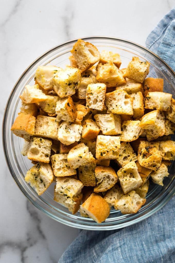 Crunchy homemade croutons in a clear bowl.
