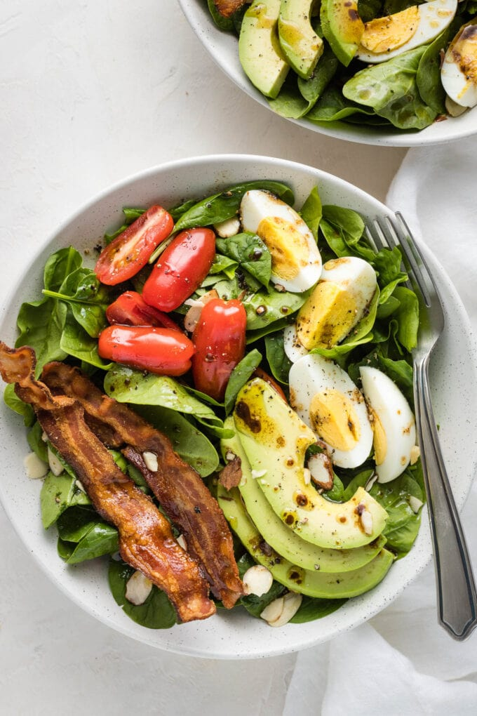 Spinach Salad With Bacon And Eggs Nourish And Fete