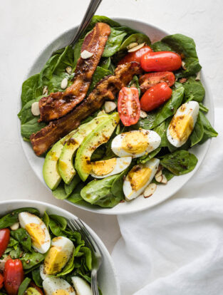 Spinach salad with bacon and eggs.