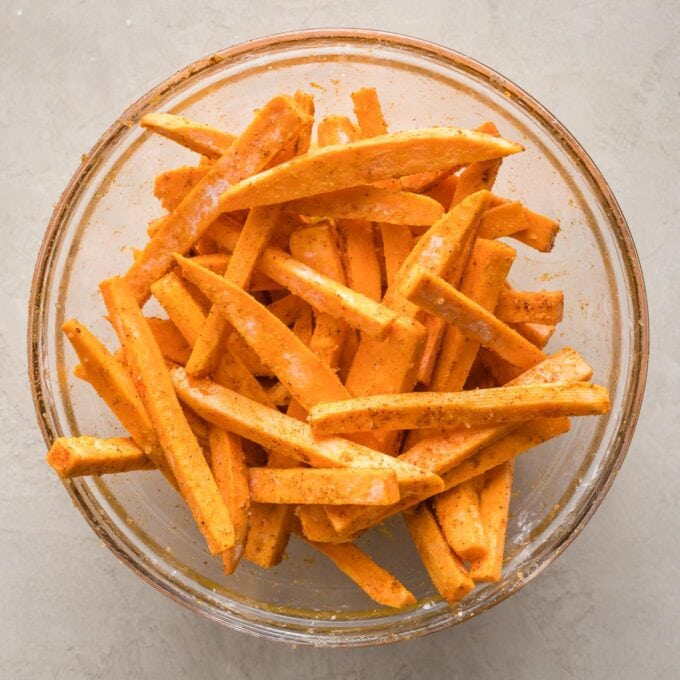 Seasoned fries in a prep bowl.