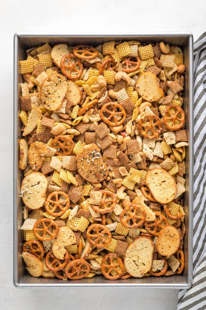 Cake pan filled with homemade Chex mix.
