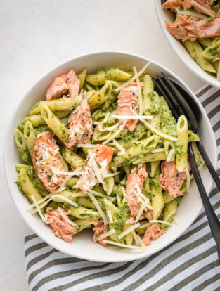 Bowls of salmon pesto pasta.