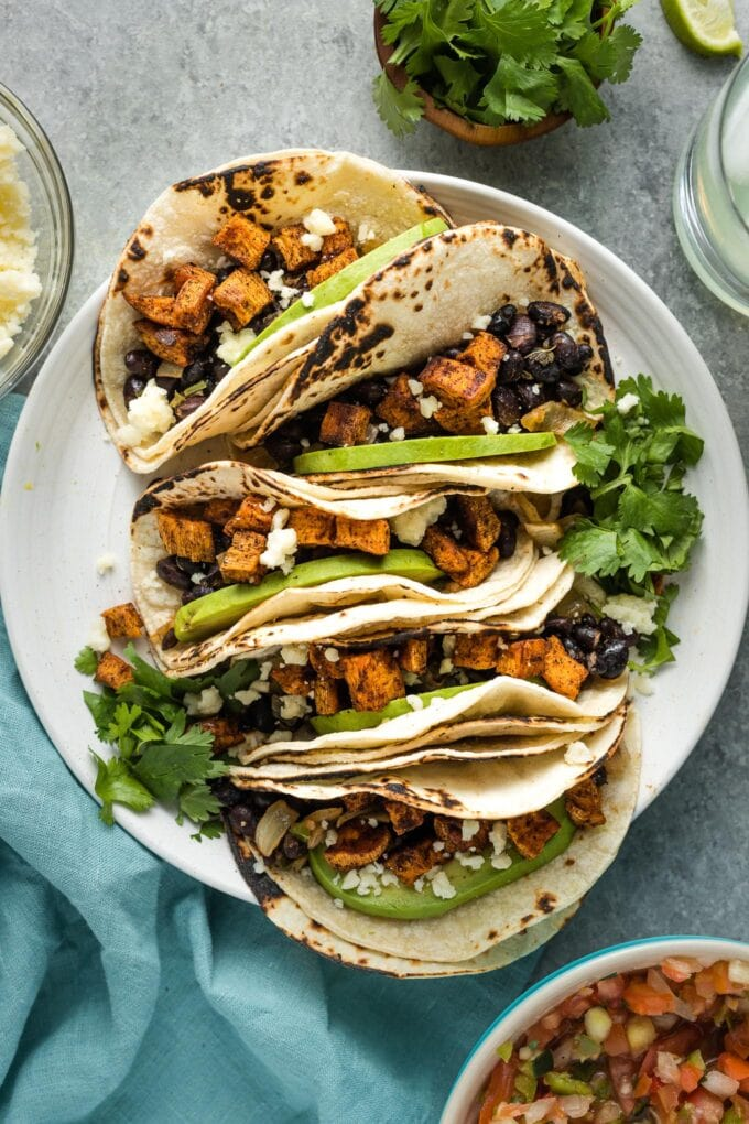Sweet potato black bean tacos served on a plate.