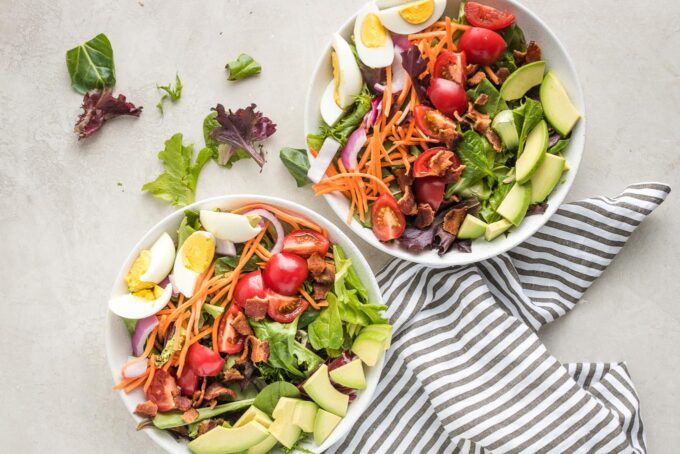 Salads with eggs and avocado added.