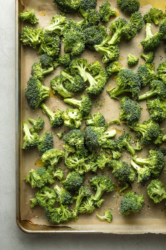 Broccoli florets on a sheet pan.