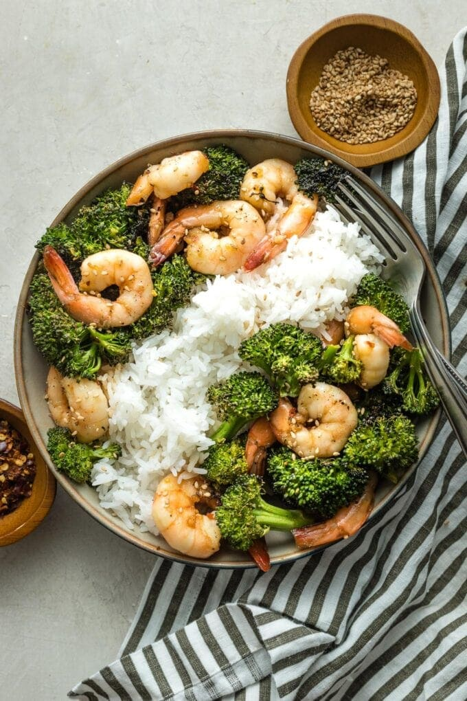 Bowl of white rice, broccoli, and honey garlic shrimp.