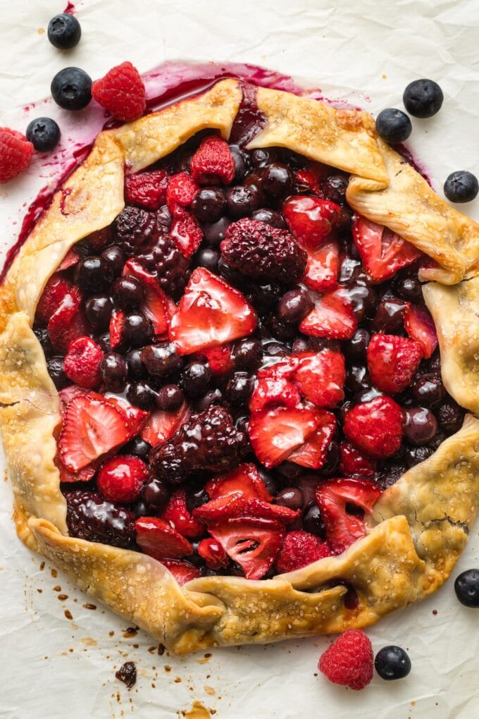 Glossy, just-baked mixed berry galette.