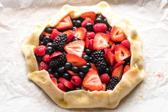 Pie crust folded up into a rim around the berries.