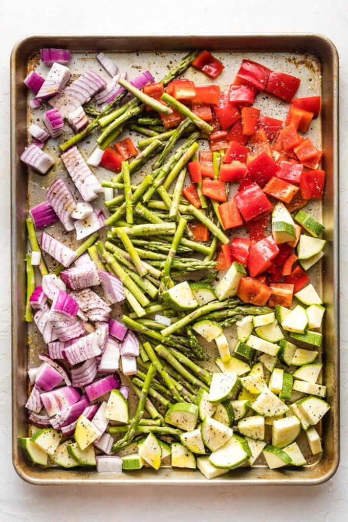 Sheet pan with cut veggies ready to roast.