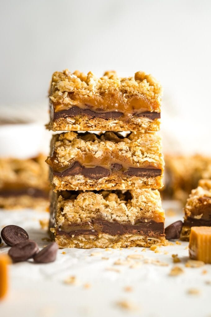 Three oat caramel bars stacked on top of each other.
