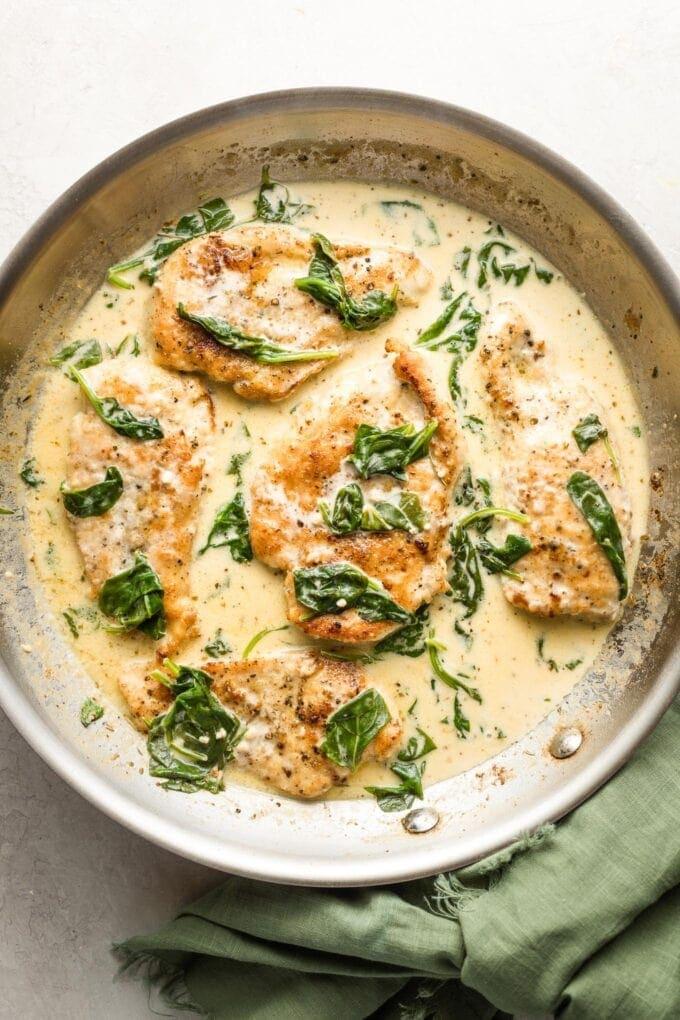 Creamy chicken Florentine, in a skillet ready to serve.