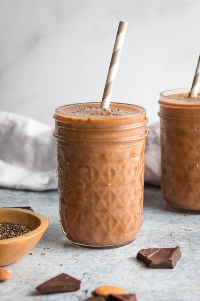 Small jar holding a chocolate almond milk smoothie.