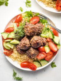 Za'atar-spiced lamb meatballs on a plate.