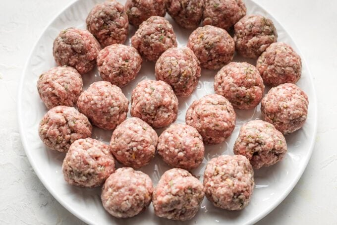 Shaped, uncooked lamb meatballs.