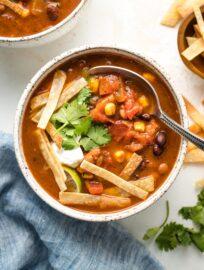 A bowl of vegetarian tortilla soup.