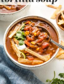 This chipotle black bean tortilla soup is easy and full of smoky, bright Mexican flavors. Gluten-free, vegan, perfect for busy weeknights!