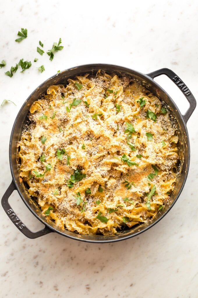 Cooked sausage noodle casserole in a pan.