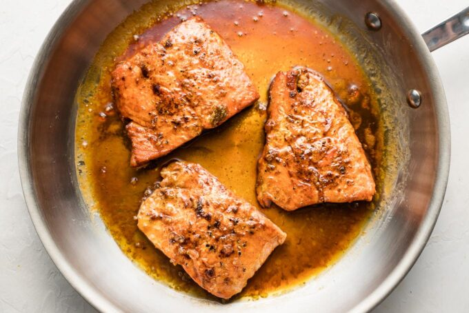 Cooked salmon filets with honey garlic sauce.