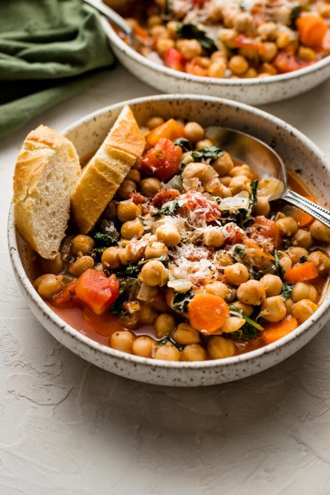 Tuscan chickpea stew served with bread and Parmesan.