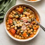 Bowl of Tuscan chickpea stew served with fresh Parmesan.