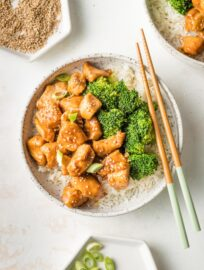 Bowl of homemade teriyaki chicken served with steamed broccoli and rice.