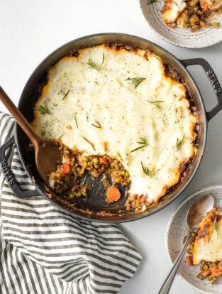 Deep skillet with a vegetarian Shepherd's pie partially served.