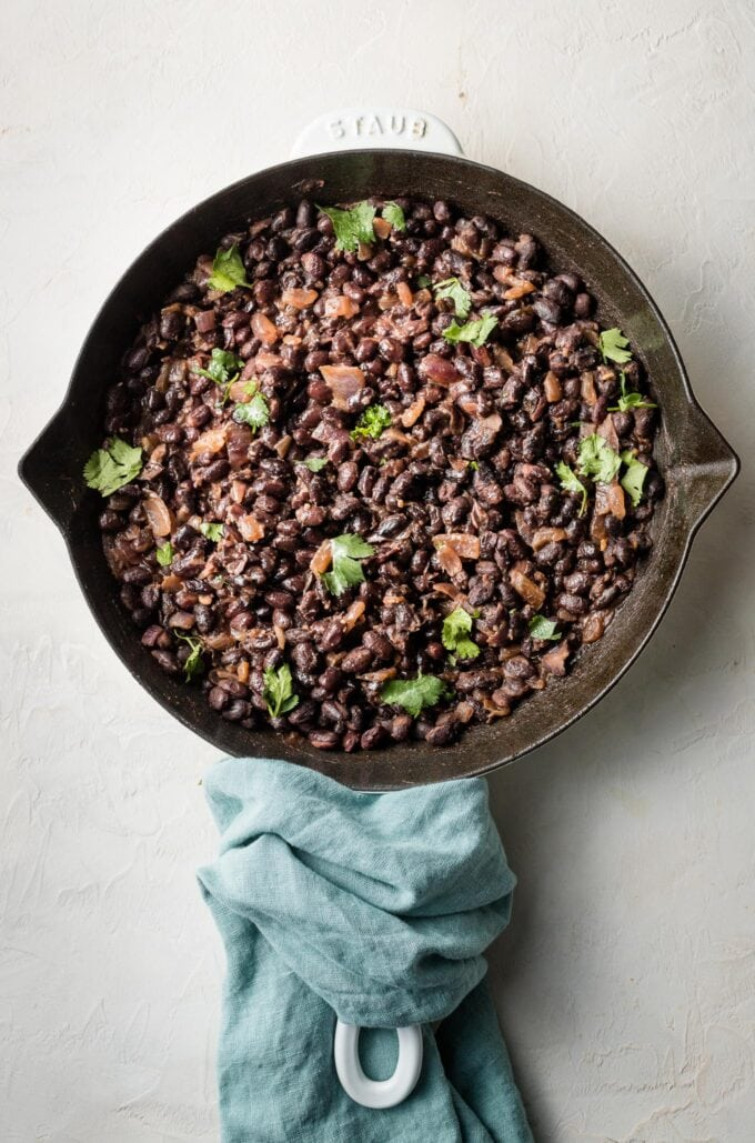Pan with cooked black beans.