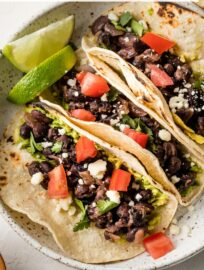 These simple Black Bean Tacos are so easy to make from pantry staples, and the filling cooks in no time. So flavorful and satisfying that you'll never miss the meat!