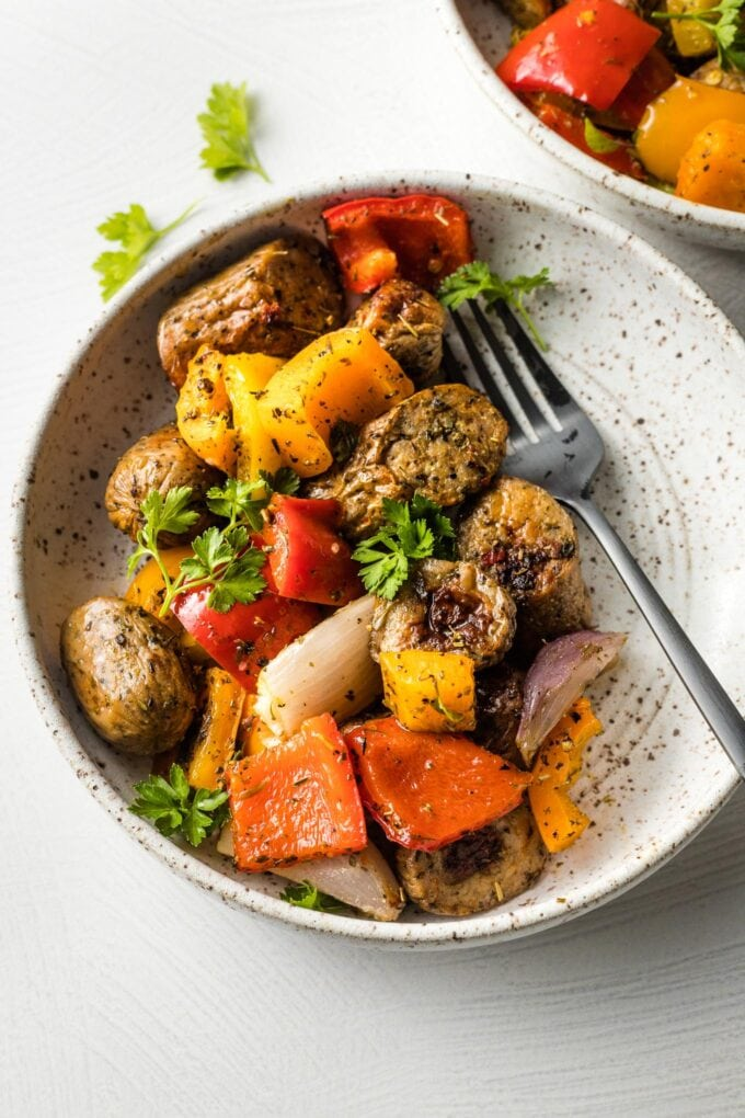 Bowl filled with sausage and peppers with fennel.