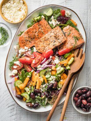 Greek salmon salad served on a white platter.
