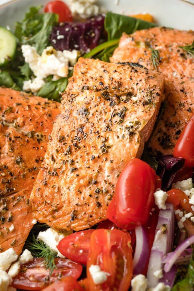 Pan-seared salmon filet seasoned with salt, pepper, and oregano.