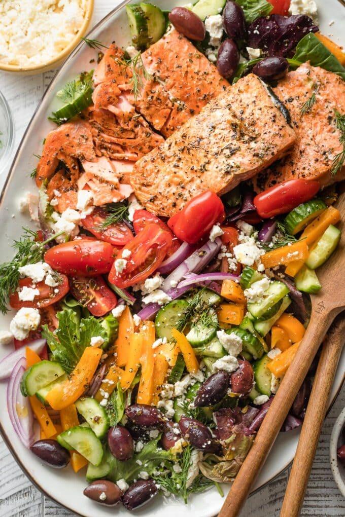 Close-up of Greek salmon salad served on a platter.