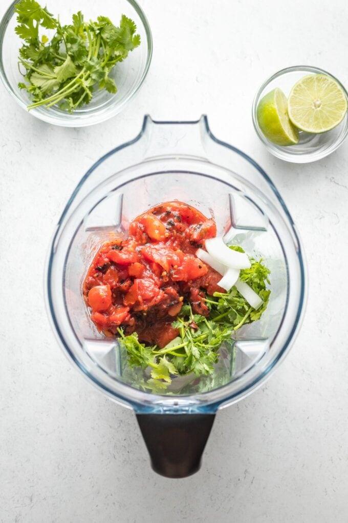 Blender with salsa ingredients, unmixed.