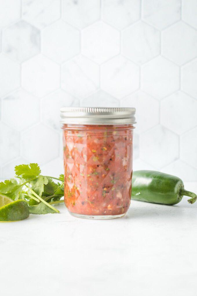 Jar of blender salsa with the lid on.
