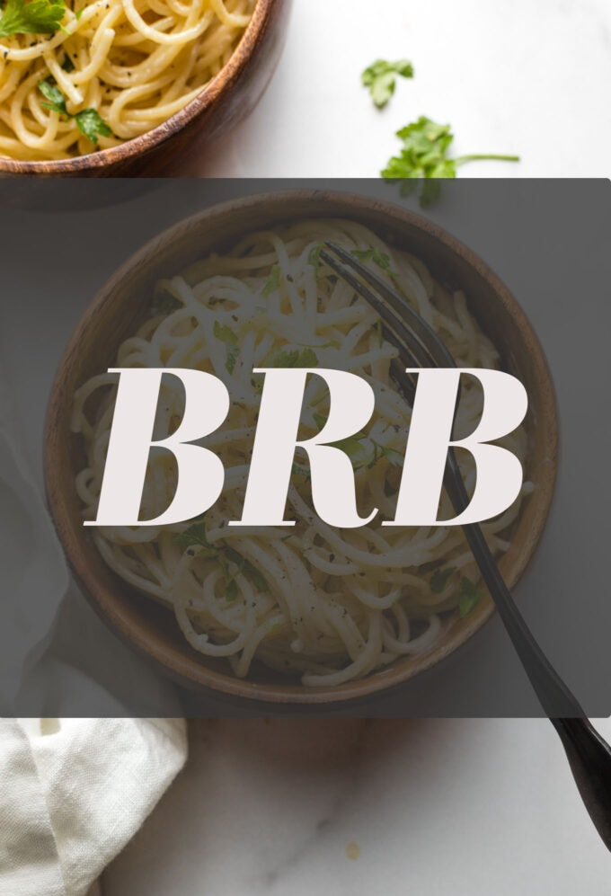 """Photo of a bowl of spaghetti with the letters """"BRB"""" superimposed on top."""