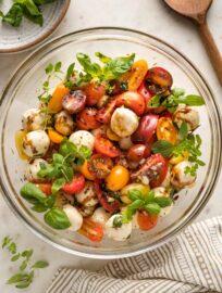 Bowl of marinated mozzarella salad.