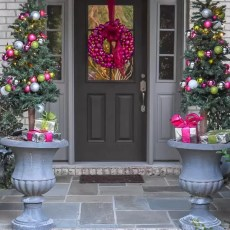 Dress your front porch for the holidays. Instructions and illustrations to make a DIY Ornament Garland with plastic ornaments, coiled wire and florist wire.