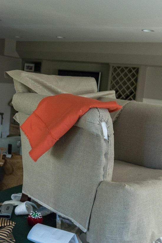 coral-fabric-on-chair-being-upholstered