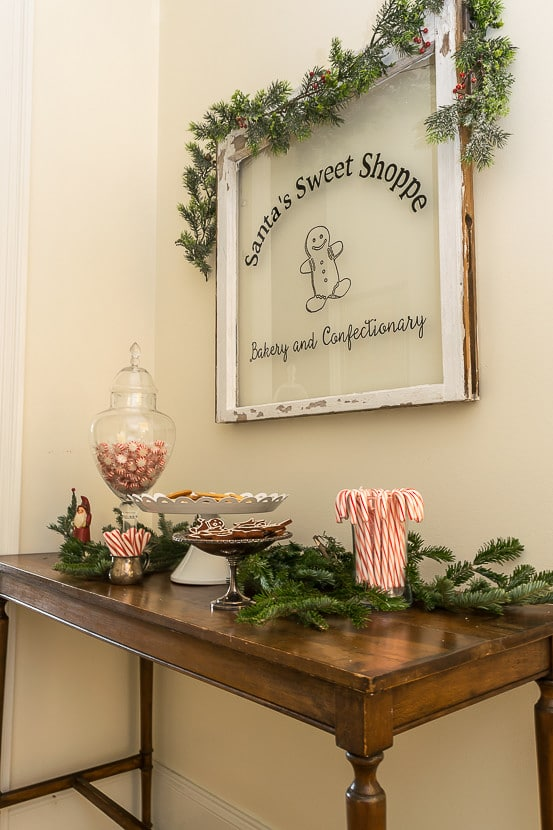 Easy to make DIY Painted Window. Add a little bakery shop charm to your Christmas decorations with this Santa's Sweet Shoppe window.
