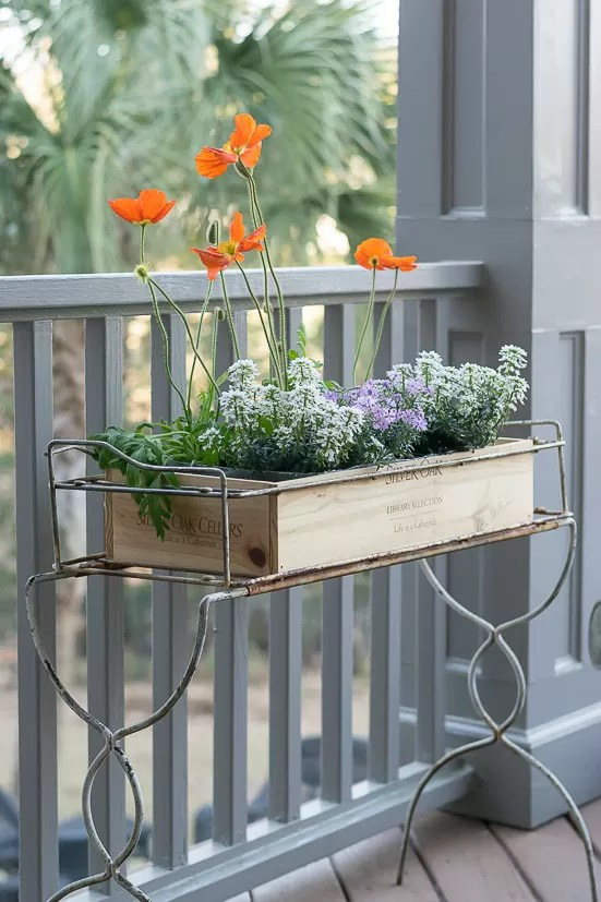I upcycled a wooden wine crate and made this fantastic wine crate planter box. It works perfectly in my old metal planter.