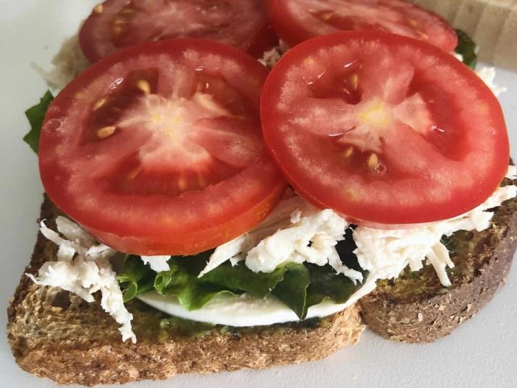 Shredded chicken pesto sandwich