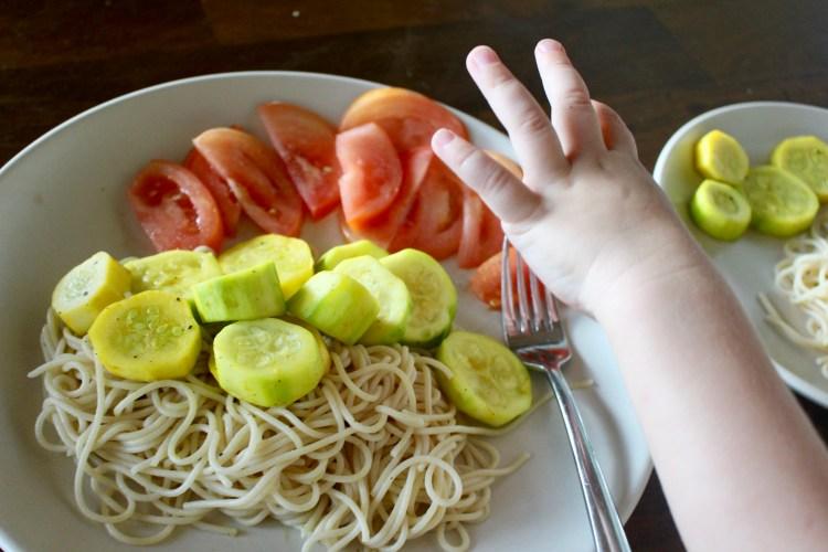 Helping hands in kitchen. Fresh vegetables.