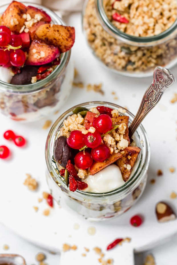 Apple Streusel Parfait Jars with red currants and a spoon