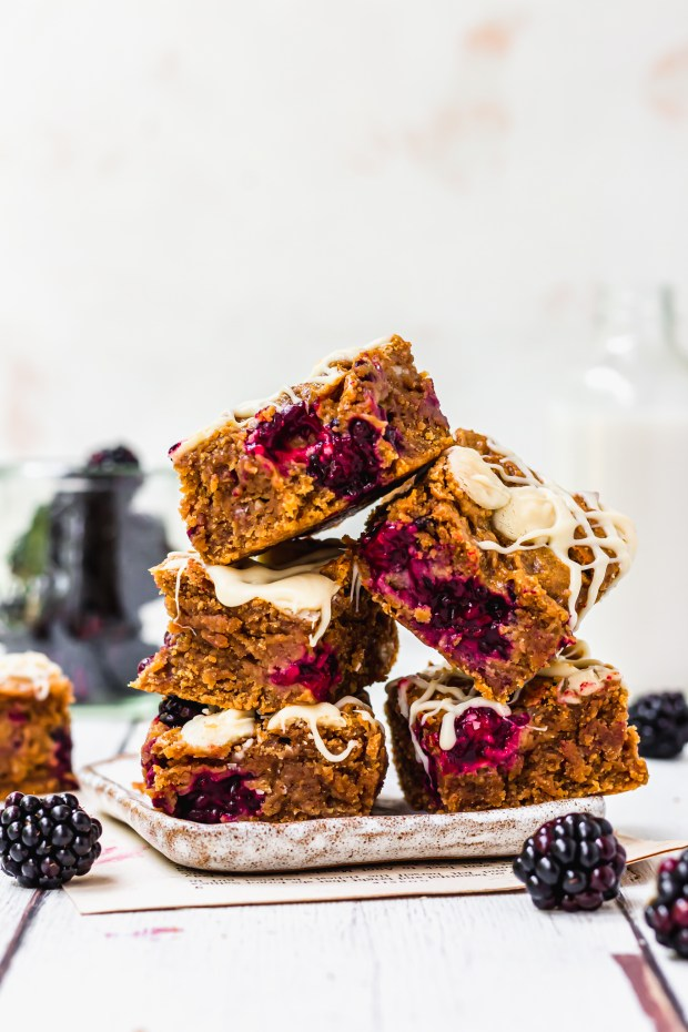 A stack of five Blackberry White Chocolate Blondies